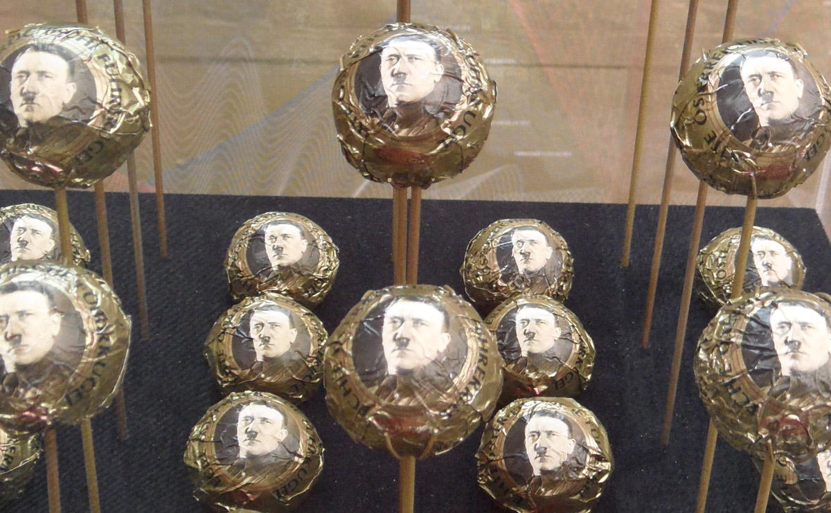 Echte österreichische Führerkugeln, Genuine Austrian Führer Balls (2014) by Bernhard Draz are chocolate balls with printed wrap and a portrait of probably the most important Austrian of all. Offered under glass at the Post-Colonial Flagship Store: