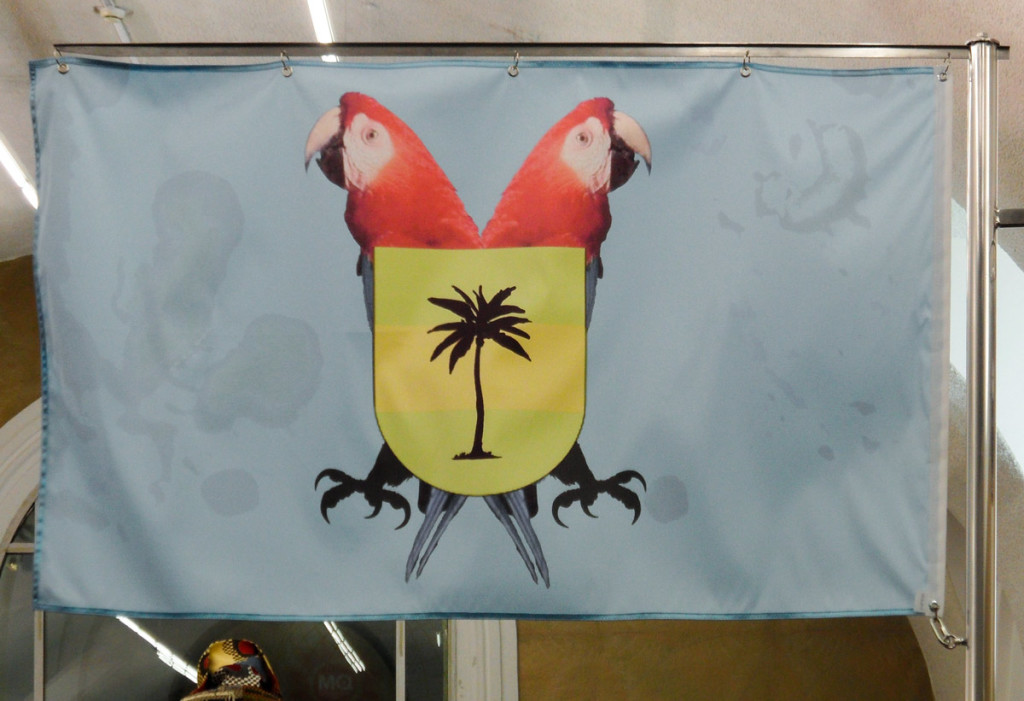 Captured (2014) by Signe Theill at the PCFS, the Post Colonial Flagship Store with a flag for the one and only overseas colony of Austria – the Nicobar Islands.