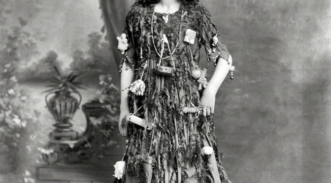 Young woman as a Christmas tree. Half-plate glass negative by Adam Maclay. New Zealand circa 1910.